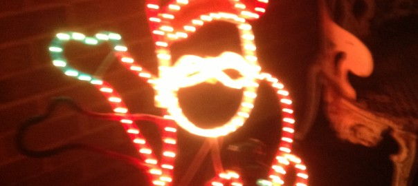 3D Santa figure made out of both flashing and static rope lights - he waves at passers by