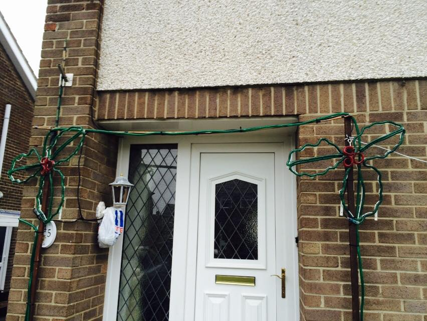 Our re-designed archway with two new holly bunches and green rope light
